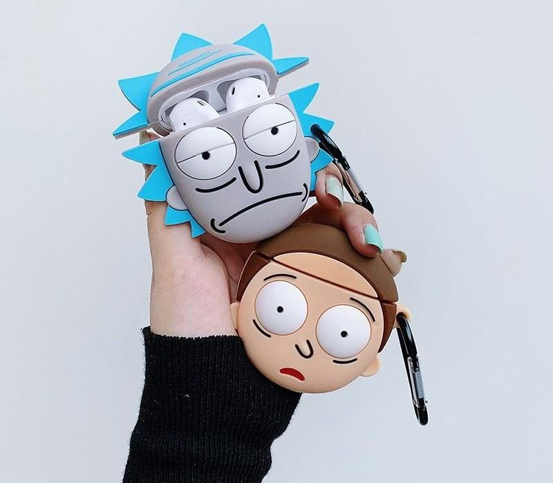 A hand holding two Rick and Morty earphone cases